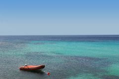Remote paradise. A small raft anchored in the open Aegean Sea royalty free stock image