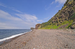 Remote Pebble Beach on a Sunny Day. On the Green Gardens Trail in Gros Morne National Park in Newfoundland, Canada stock photo