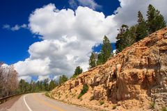 Remote road. A road and a cloudy blue sky in American Southwest Royalty Free Stock Images
