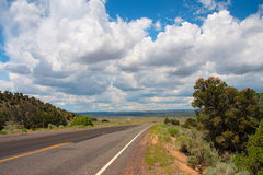 Remote road. A road and a cloudy blue sky in American Southwest Stock Photography