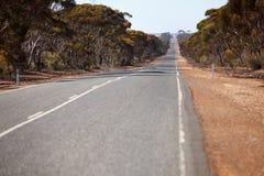 Remote road in australian bush Stock Photos