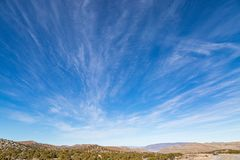 A Nevada Desert Landscape. A remote road in the Nevada desert, with a vast sky overhead royalty free stock photography