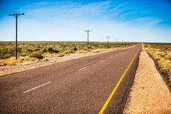 Remote Road. A remote road in the Northern Cape in South Africa. This road runs north from Upington towards the Kgalagadi Transfrontier park. It is very far stock photography