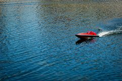 Remote ship toy. Red remote ship toy in river Stock Photography