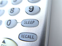 Remote with sleep button. TV Remote control with focus on the sleep button, closeup Stock Photos