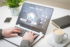 Remote smart home control system on a laptop. Home smart system automated connection room thermostat control display monitoring laptop house remote internet Royalty Free Stock Photography