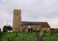 English 14th century parish church. The remote St Botolph church is the  parish church for Tottenhill in Norfolk and was originally built in the 14th century royalty free stock photography