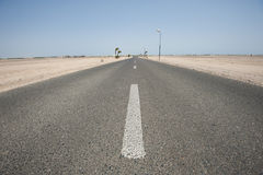 Remote straight desert road to infinity Royalty Free Stock Photography