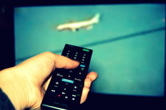 Remote with television Royalty Free Stock Photos