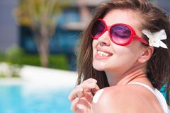 Young woman applying sun cream uv protection stock images