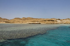 Remote Tropical Island and Coral. Tiran island in the Red Sea surrounded by coral Stock Photos