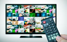 Remote and TV with images. Remote and TV with multiple images gallery Royalty Free Stock Image