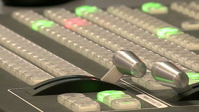 The remote is in the TV Studio . Wide shot of vision mixing panel in a television gallery stock footage