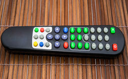 Remote tv on wood backgrounds Stock Photos