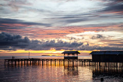 Remote Village Pier and Sunset Royalty Free Stock Image
