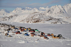 Remote village in winter, Greenland. Houses in the Kulusuk village, Greenland Royalty Free Stock Photos