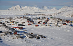 Remote village in winter, Greenland. Houses in the Kulusuk village, Greenland Stock Photos