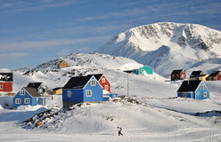 Remote village in winter, Greenland. Houses in the Kulusuk village, Greenland Royalty Free Stock Image