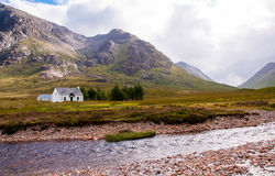 Remote white cabin in the highlands Royalty Free Stock Photography