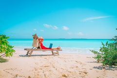 Remote work concept -young woman with laptop on beach. Remote work concept -young woman with laptop on tropical beach Stock Photos