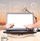 Remote work. Working remotely in virtual office using laptop on beach at sunrise Stock Photography