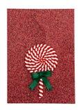 Remous rouge de lucette sur le fond rouge Traitement au four de Noël Concept de vacances Copiez l'espace Configuration plate Image libre de droits