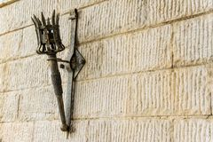 Removable iron torch on a medieval castle stone wall royalty free stock photos