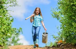 Removable rose allows moderate flow. Gardening tips. Spring gardening. Girl child hold shovel watering can. Spring stock photos