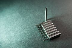 Removable screwdriver bits, nine in a row, a torx stock photo