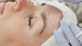 Removal of anesthesia cream. Permanent makeup. Permanent tattooing of eyebrows. stock video