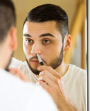 Removal of hair from nose Royalty Free Stock Image