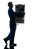 Removal man with boxes silhouette Stock Photo