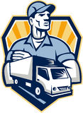 Removal Man Delivery Truck Crest Retro. Illustration of a removal man delivery guy with moving truck van in the foreground set inside shield crest done in retro Stock Photos
