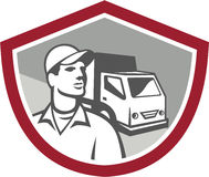 Removal Man Delivery Van Shield Retro. Illustration of a removal man delivery guy with moving truck van in the background set inside shield on isolated Stock Images