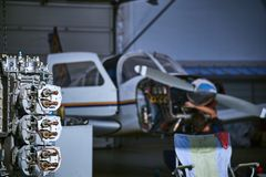 Removal and repair of an airplane engine by a service worker. Replacing the defective parts of the aircraft service worker stock photo