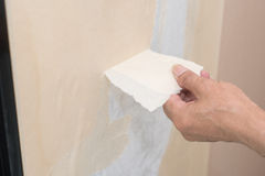 Removal of wallpaper. Royalty Free Stock Photo