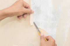 Removal of wallpaper. Stock Photography