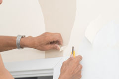 Removal of wallpaper. Royalty Free Stock Image