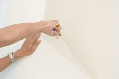 Removal of wallpaper. Stock Photo