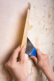 Removal of wallpapers with spatula Royalty Free Stock Photo