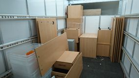A removals van filled with office furniture. A house clearance removal Luton lorry truck vehicle with home furniture from an office bankruptcy liquidated stock stock photos