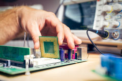 Remove CPU from main circuit board to check problem and repair Royalty Free Stock Image