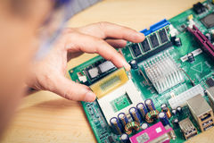 Remove CPU from main circuit board to check problem and repair Stock Images