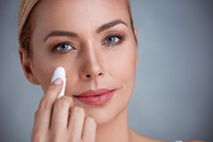 Remove dark circles. Woman remove dark circles under eyes Royalty Free Stock Photos