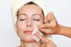 Remove facial hair. Facial hair depilation in a beauty spa royalty free stock photos