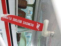 Remove Before Flying. Banner showing a pin to pull before flying the aircraft Stock Photo