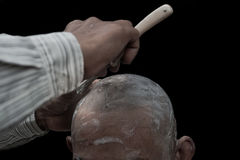 Remove hair to ordaining. In Buddhism  on black background Royalty Free Stock Photo