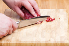 Remove with a knife the fat on fillet Royalty Free Stock Photography