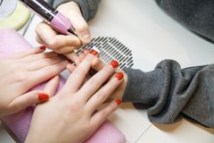 Remove Old Nail Polish, manicure. Milling of nails. Removing the nail plate with a milling machine royalty free stock image
