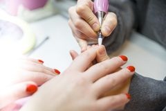 Remove Old Nail Polish, manicure. Milling of nails. Removing the nail plate with a milling machine stock photography